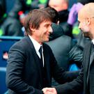 Chelsea manager Antonio Conte (left) with Manchester City manager Pep Guardiola