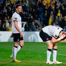 Dundalk's Brian Gartland (R) reacts as Maccabi score the first