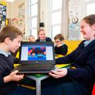Birthday boy Tiernan Mangan and fellow pupil Anna Farragher celebrate with a digital cake at Cloghans Hill National School in Co Galway. Photo: Andrew Downes