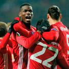 Manchester United's players celebrate after their first goal