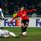 Henrikh Mkhitaryan scores his first goal for Manchester United. Photo: Peter Cziborra / Reuters