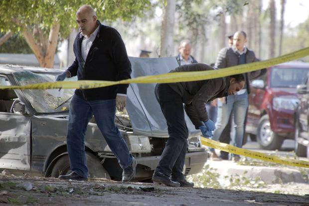 The site of a bomb explosion in Cairo which killed six police officers (AP Photo/Amr Nabil)