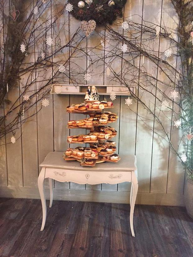 An image of a Rolling Donut wedding cake. The stand was created by Dynamic Cater Care