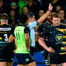Northampton Saints' Dylan Hartley is shown a red card by referee Jerome Garces