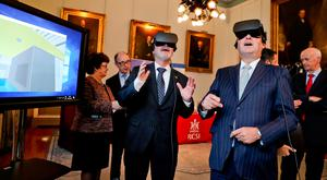 EIB president Werner Hoyer, left, tries on a VR headset during a tour of the RCSI in Dublin Picture: Maxwells