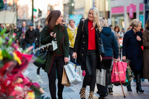 Shoppers carry Christmas shopping on Grafton Street, Dublin. Photo: Mark Condren