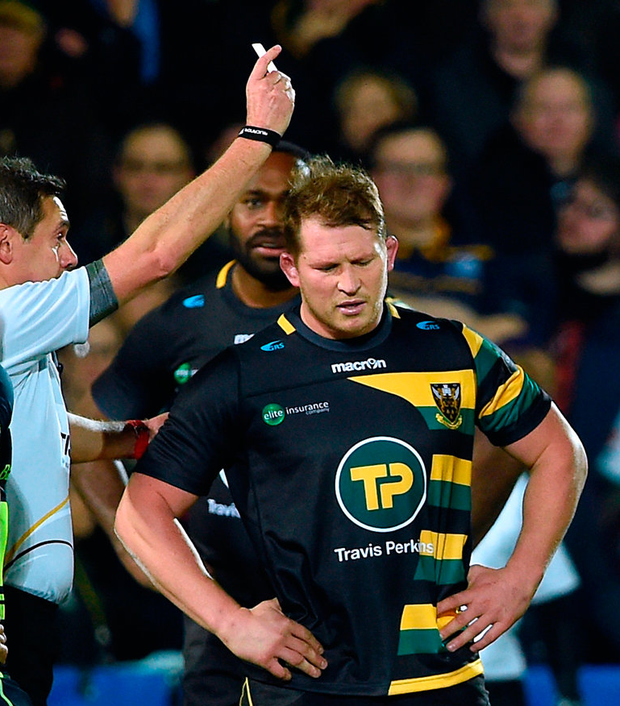 Northampton Saints' Dylan Hartley is shown a red card by referee Jerome Garces. Photo: PA