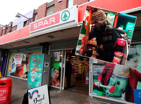 Thug armed with hammer raids the Spar shop