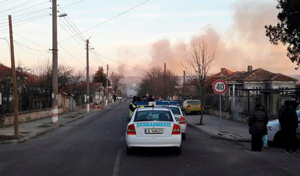 Smoke rises after a cargo train derailed and exploded in the village of Hitrino, Bulgaria, December 10, 2016. Bulphoto Agency/via REUTERS
