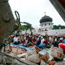 Survivors perform Friday prayer at a mosque badly damaged by December's earthquake in Tringgading, Aceh province, Indonesia (AP Photo/Binsar Bakkara)