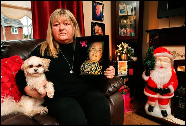 Lisa Angan holds a photo of her daughter Jessica Bingham taken 12 hours before she passed away alongside Jessica's dog 'Frankie'. Photo by Steve Humphreys