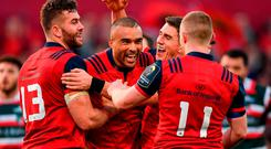 Simon Zebo of Munster celebrates with team-mates Jaco Taute, left, Ian Keatley and Keith Earls after scoring their side's first try during the European Rugby Champions Cup Pool 1 Round 3 match between Munster and Leicester Tigers at Thomond Park in Limerick. Photo by Brendan Moran/Sportsfile
