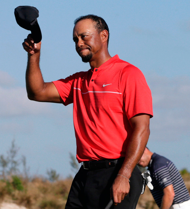 Tiger Woods walks off the 18th green during the final round at the Hero World Challenge golf tournament last Sunday, in the Bahamas. Photo: Lynne Sladky/AP