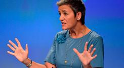 EU Commissioner Margrethe Vestager gestures during a news conference on Ireland's tax dealings with Apple at the EC in Brussels in August