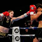 Katie Taylor (L) in action against Viviane Obenauf