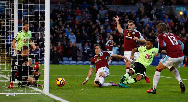 Burnley's Stephen Ward hits home his team's second goal in their 3-2 win over Bournemouth. Pic: Reuters