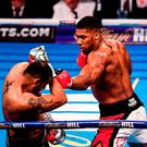 Anthony Joshua, right, exchanges punches with Eric Molina
