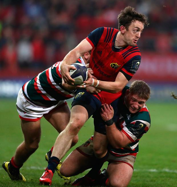 Munster's Darren Sweetnam of Munster moves between Adam Thompstone and Tom Youngs. Photo: Getty Images