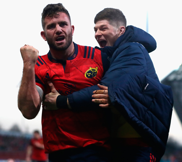 Munster's Jaco Taute (left) celebrates with replacement Jack O'Donoghue after scoring a try. Photo: Getty Images