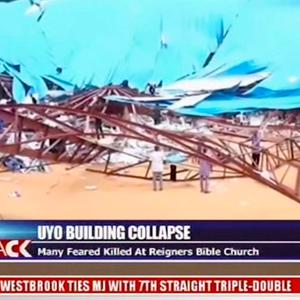 In this image taken from video people stand at the scene after the roof of The Reigners Bible Church International collapsed onto worshippers in Uyo, southern Nigeria (Channels TV via AP)