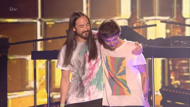 Louis gets a hug from Steve Aoki who performs on the track with him. Credit: X Factor/ITV