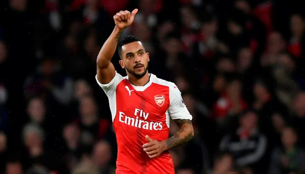 Arsenal's Theo Walcott celebrates scoring yesterday