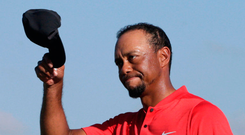 Tiger Woods walks off the 18th green during the final round at the Hero World Challenge golf tournament in the Bahamas. Photo: Lynne Sladky/AP