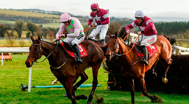 Eventual winner Djakadam, with Ruby Walsh up, lands over the final fence just ahead of runner-up Outlander (Davy Russell) and Sub Lieutenant (Bryan Cooper) on the way to capturing the John Durkan Memorial Steeplechase at Punchestown yesterday. Photo by Cody Glenn/Sportsfile