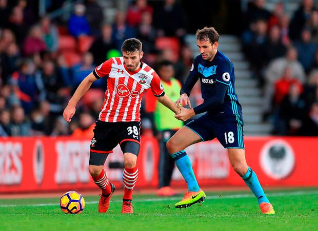 Southampton's Sam McQueen (left) and Middlesbrough's Cristhian Stuani battle for the ball. Photo: John Walton/PA Wire.