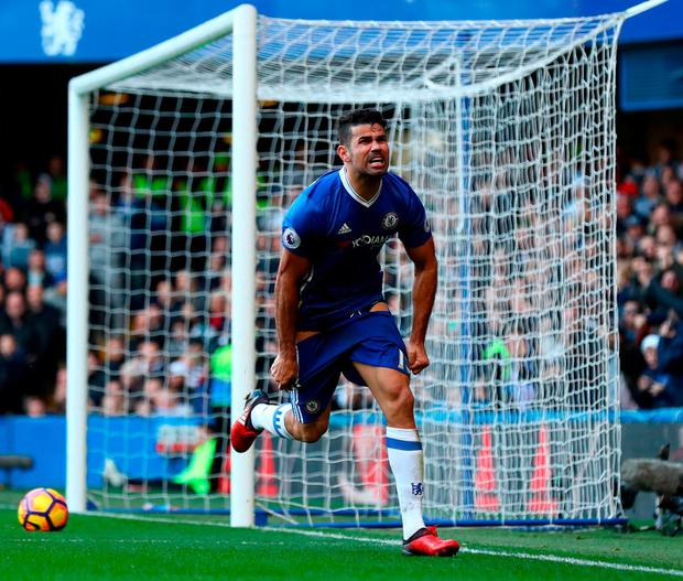Diego Costa turns away in celebration after socring the winner for Chelsea at Stamford Bridge. Photo: Clive Rose/Getty Images