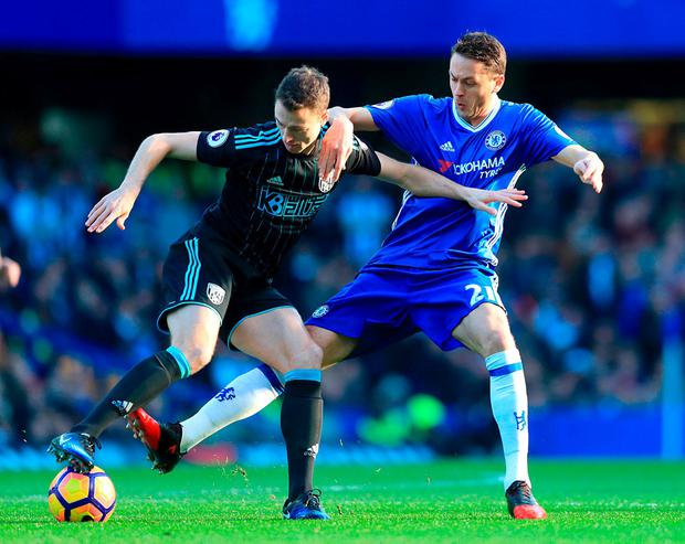West Bromwich Albion's Jonny Evans (left) and Chelsea's Nemanja Matic battle for the ball. Photo: Adam Davy/PA Wire.