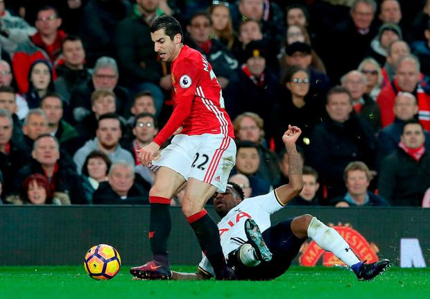 Manchester United's Henrikh Mkhitaryan is challenged by Tottenham Hotspur's Danny Rose. Photo: Martin Rickett/PA Wire.