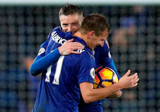 Leicester City's Jamie Vardy celebrates with Marc Albrighton whilst holding the match ball at the end of the match after scoring a hat-trick. Photo: Darren Staples/Reuters