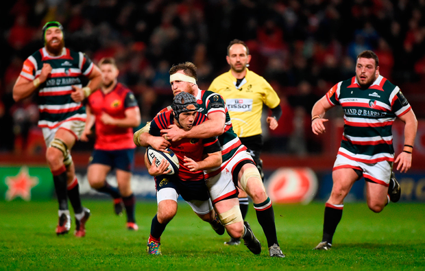 Duncan Williams of Munster is tackled by Brendon O'Connor of Leicester Tigers. Photo by Diarmuid Greene/Sportsfile