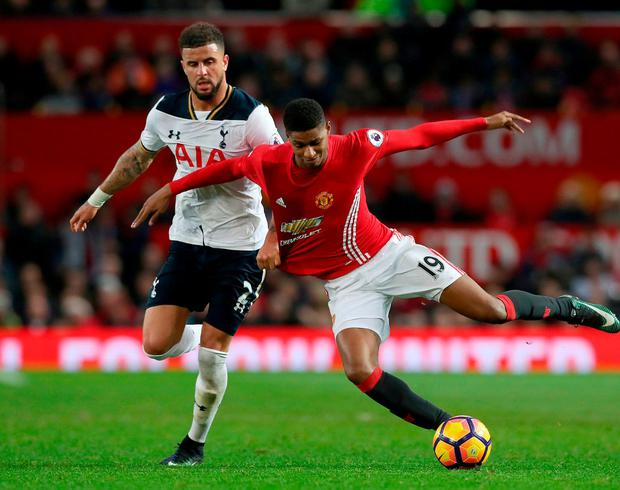 Tottenham Hotspur's Kyle Walker and Manchester United's Marcus Rashford battle for the ball. Photo: Martin Rickett/PA Wire.
