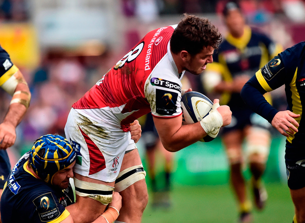 Sean Reidy of Ulster is tackled by Flip van der Merwe of ASM Clermont Auvergne. Photo by Oliver McVeigh/Sportsfile
