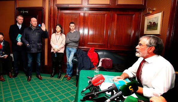 Austin Stack (hand raised) confronts Sinn Fein leader Gerry Adams TD (far right) at the party's launch of its Brexit document in the Davenport Hotel in Dublin last Thursday. Photo: Tom Burke