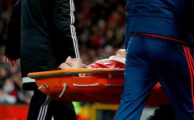 Manchester United's Henrikh Mkhitaryan (Centre) is carried off the pitch in a stretcher after picking up an injury during the Premier League match at Old Trafford yesterday