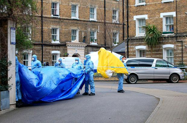 Police forensic officers near the Great Guildford Street entrance to the Southwark Street Estate in south London, after the remains of Pc Gordon Semple, 59, were found at a property on the estate. Jonathan Brady/PA Wire