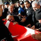 Mehmet Capat ,father of Yakup Capat, a Turkish police officer killed in Saturday's blasts in Istanbul, mourns during his funeral ceremony in Ankara, Turkey, (Phoyo: REUTERS)
