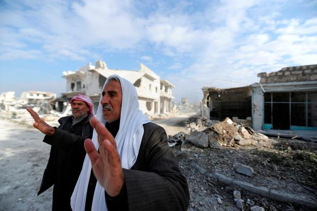 An elderly man reacts in the government held Sheikh Saeed district of Aleppo, during a media tour, Syria December 12, 2016. REUTERS/Omar Sanadiki
