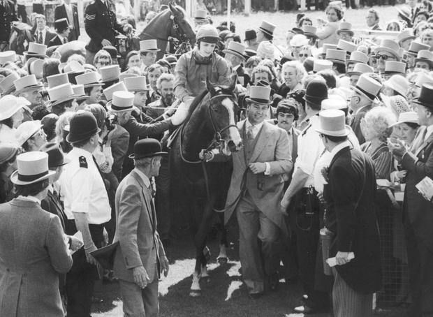 Walter Swinburn and Shergar are led into the winner's enclosure by the Aga Khan after winning the 1981 Epsom Derby. Photo by Central Press/Hulton Archive/Getty Images