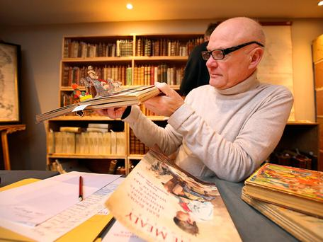 James Howell, from James Howell rare books, examines a pop-up book before the Fonsie Mealy annual rare book auction which takes place in the Gresham Hotel. Photo: Frank McGrath