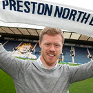 Daryl Horgan holds aloft the Preston scarf after the club confirmed his arrival at Deepdale yesterday. Photo