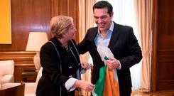 Tánaiste Frances Fitzgerald hands Greek Prime Minister Alexis Tsipras an Irish Tricolour. Photo: Andrea Bonetti