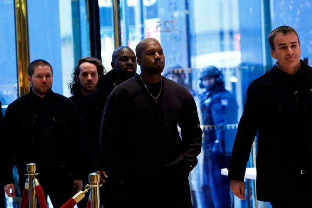 Musician Kanye West arrives for a meeting with U.S. President-elect Donald Trump at Trump Tower in Manhattan, New York City, U.S., December 13, 2016. REUTERS/Andrew Kelly