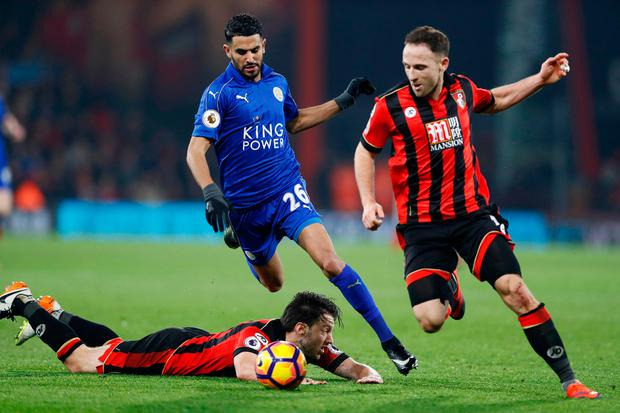Bournemouth's Harry Arter and Marc Pugh in action with Leicester City's Riyad Mahrez