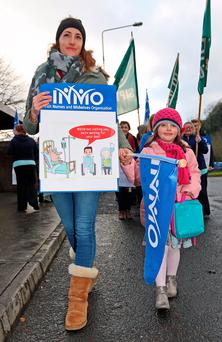 Lily Dolan (4) supports her mother Fionnuala as they walk the picket line at Cavan General Hospital yesterday afternoon. Photo: Lorraine Teevan