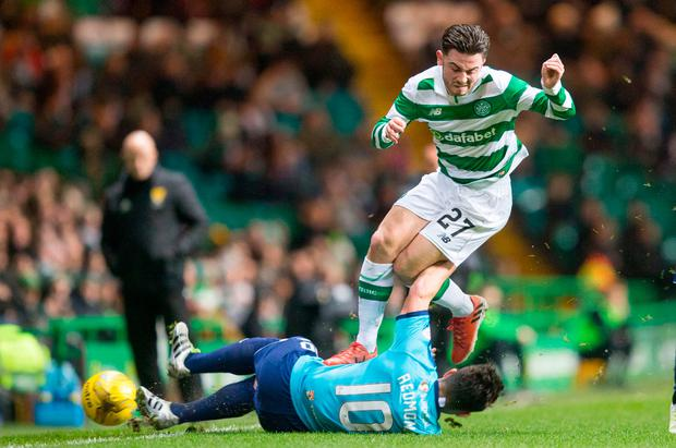 Celtic's Patrick Roberts and Hamilton's Daniel Redmond battle for the ball