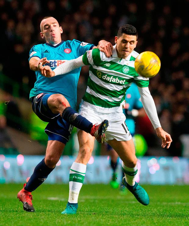 Celtic's Tom Rogic (right) and Hamilton's Darian McKinnon battle for the ball during the Ladbrokes Scottish Premiership match at Celtic Park, Glasgow Picture: PA